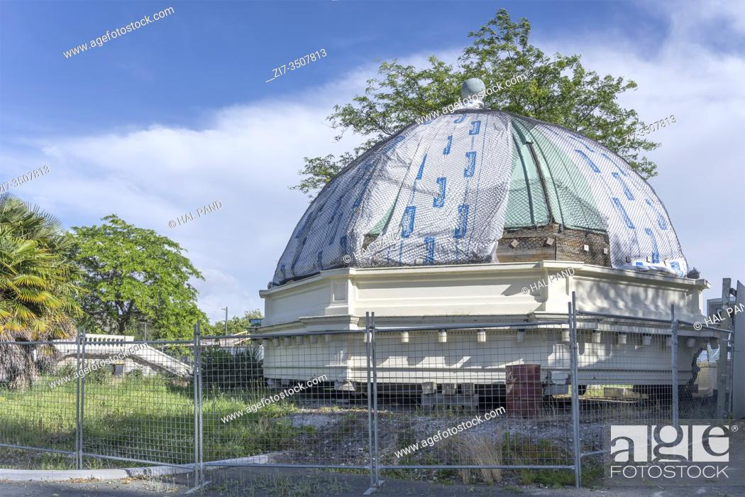 Stock Photo: CHRISTCHURCH, NEW ZEALAND - December 03 2019: cityscape with collapsed dome of earthquake damaged gazebo, shot in bright cloudy light on december 03 2019 at.