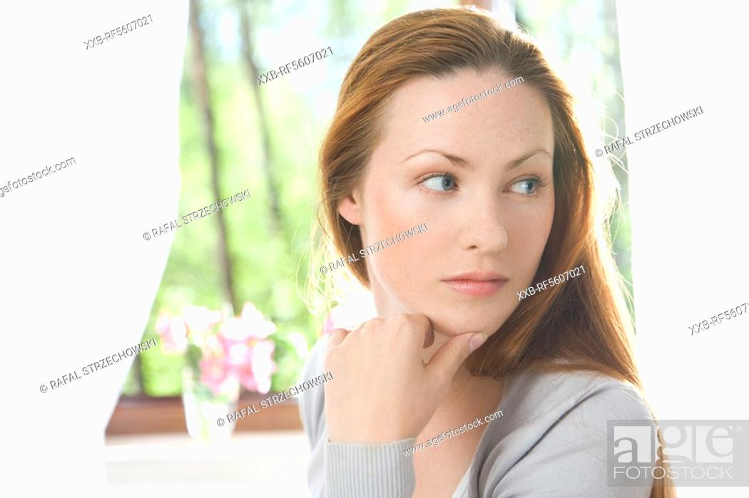 Stock Photo: woman looking right.