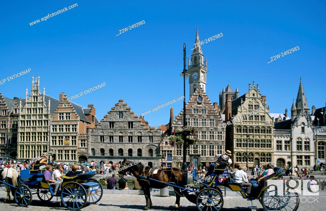 Stock Photo: Tourist sightseeing from horse drawn carriages in Ghent , Flanders, Belgium.