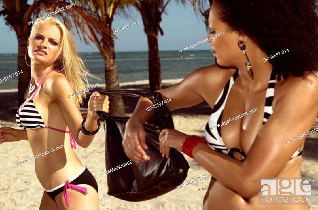 Stock Photo: Women fighting over handbag.