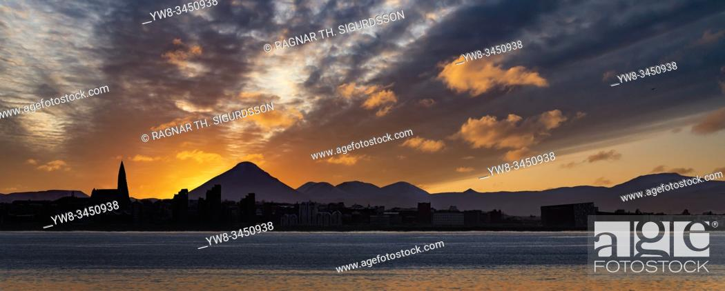 Stock Photo: Sunset, Reykjavik Skyline, Hallgrimskirkja Church and Mt. Keilir, Reykjavik, Iceland.