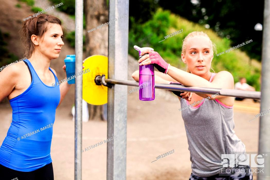 Stock Photo: Women relaxing at outdoor gym.