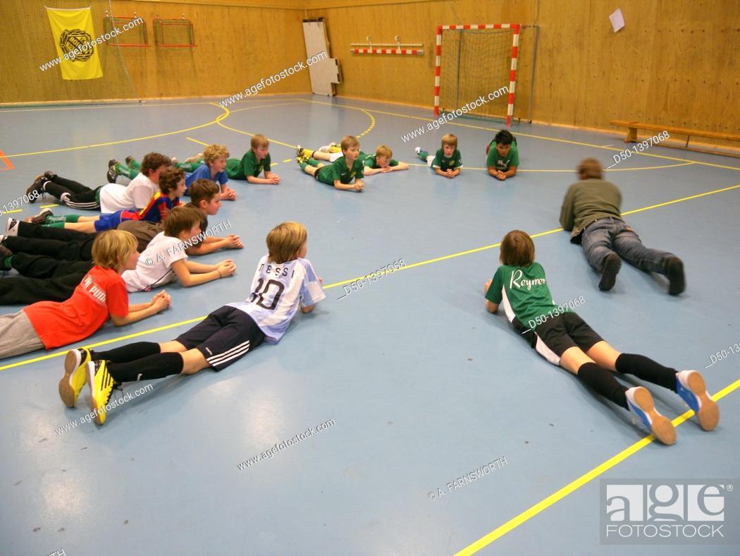 Stock Photo: Soccer practive for 10 year olds, Stockholm, Sweden.