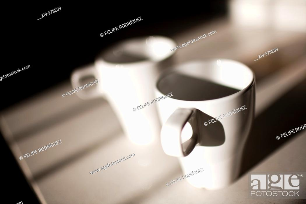 Stock Photo: Couple of coffe mugs, Seville, Spain.