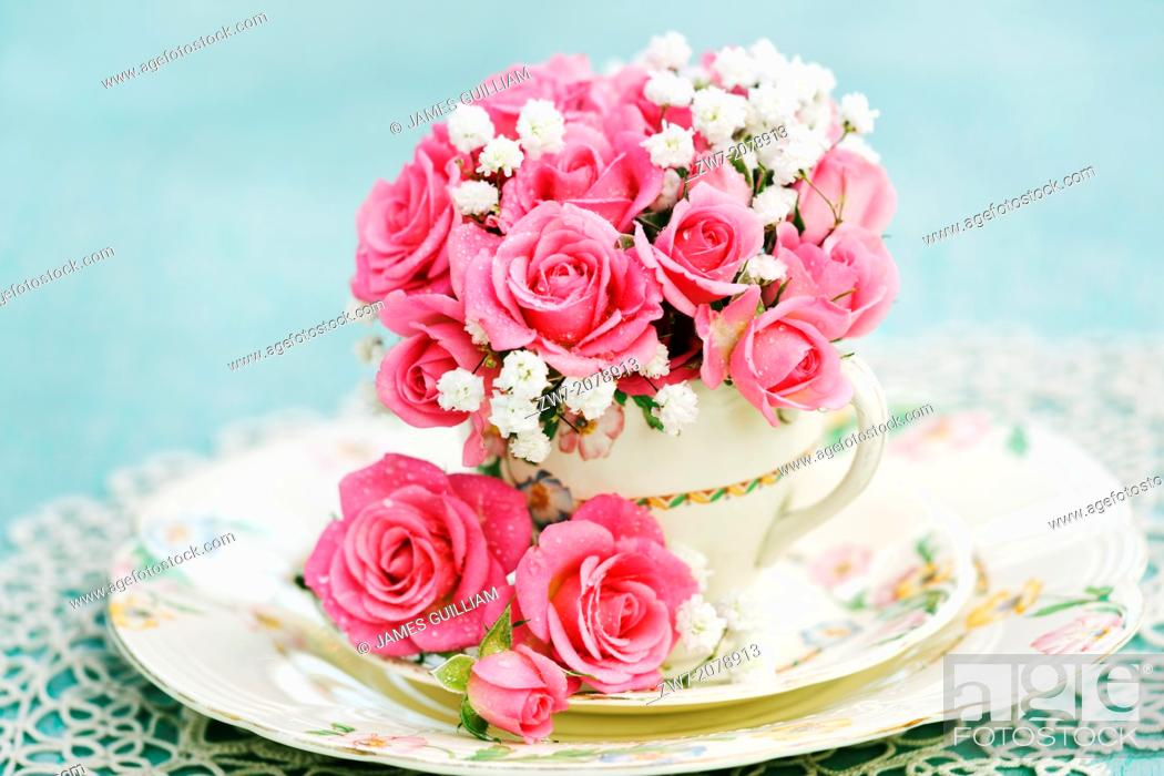Stock Photo: Pink Roses in Rose paterned Antique china tea cup with saucer and tea plate.