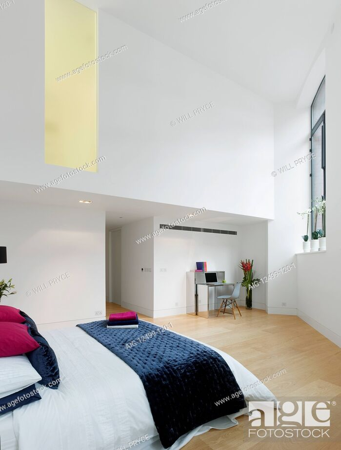 Stock Photo: Bedroom of apartment in converted Royal Mail Sorting Office, London, UK.