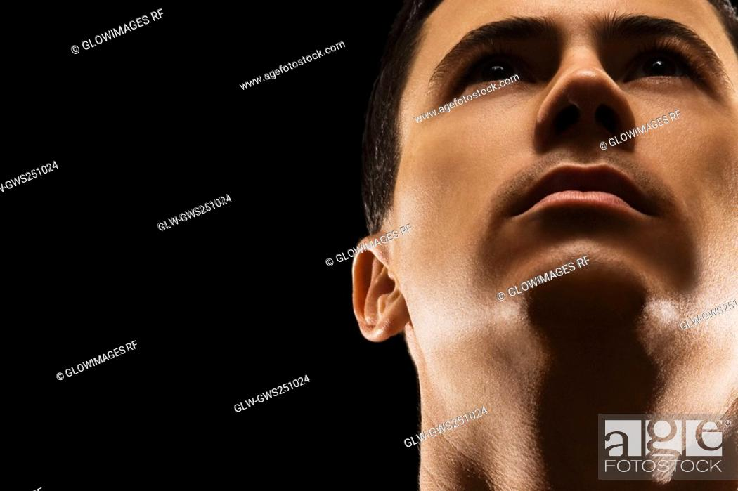 Stock Photo: Close-up of a young man thinking.