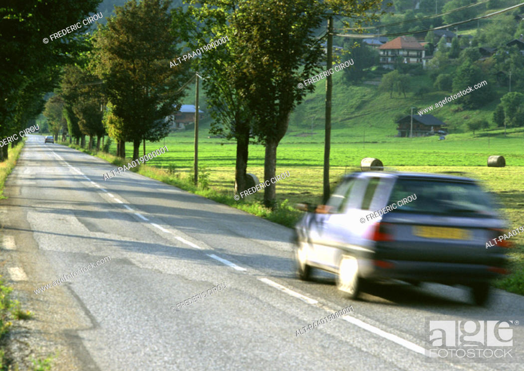 Stock Photo: Fast moving car on road, blurred motion.