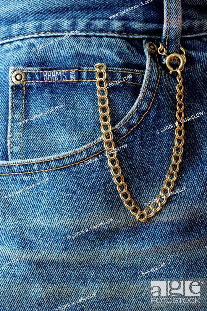 Stock Photo: Pocket watch in blue jean fifth pocket.