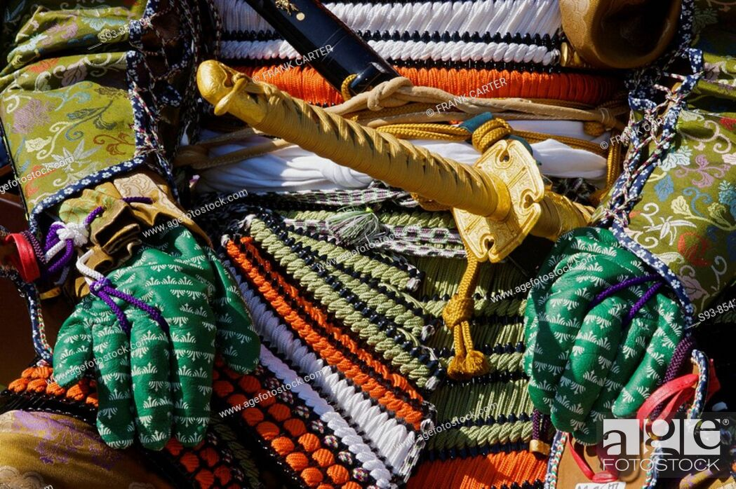 Stock Photo: A close-up of the front of a Japanese dressed up as a samurai for the Jidai Matsuri Festival of Ages in Kyoto, showing swords and colorful body armor.