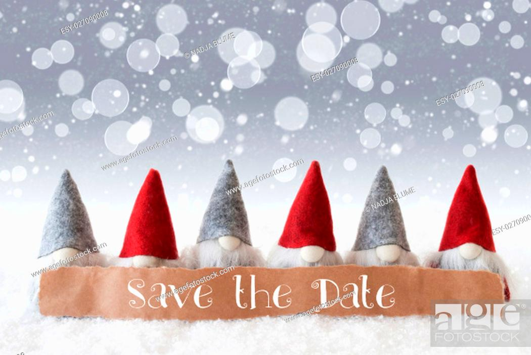 Stock Photo: Label With English Text Save The Date. Christmas Greeting Card With Gnomes. Sparkling Bokeh And Silver Background With Snow And Snowflakes.