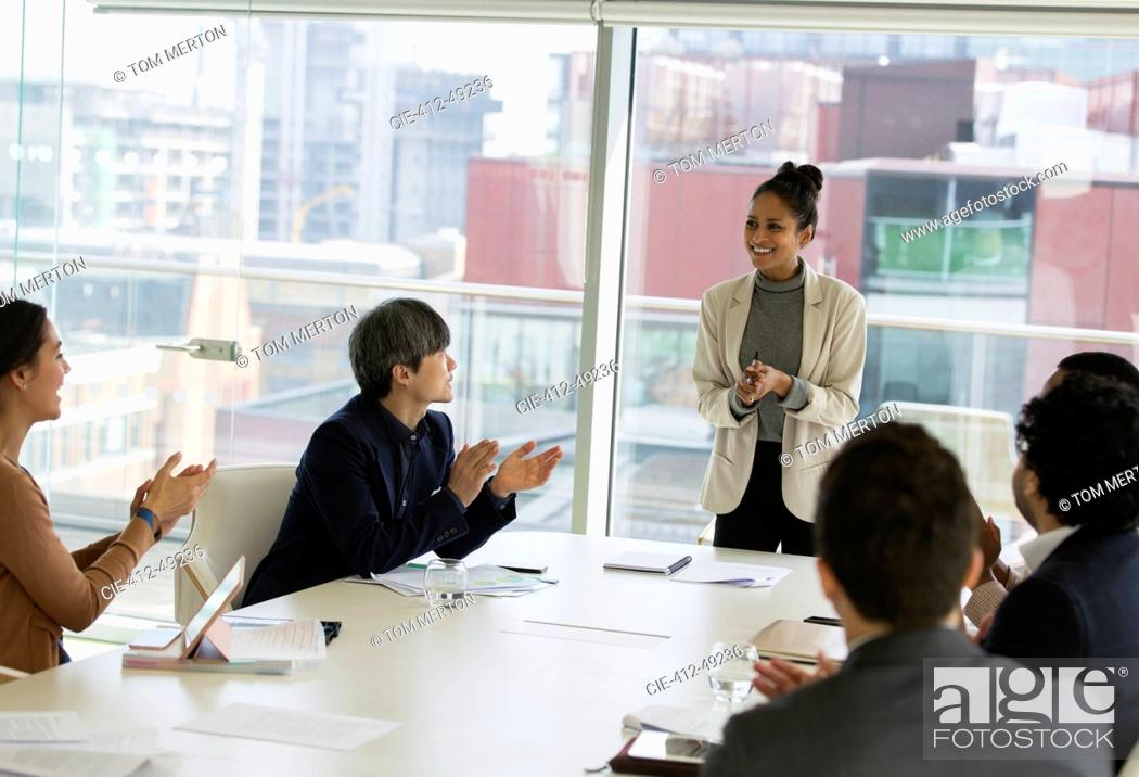Stock Photo: Businesswoman leading conference room meeting.