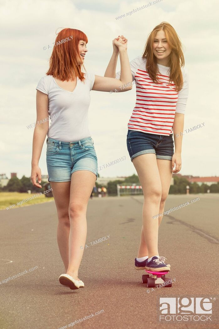Stock Photo: Two young women with skateboard.