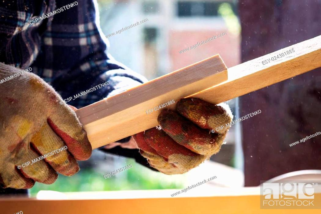 Stock Photo: Carpenter working with wood, close up photo.