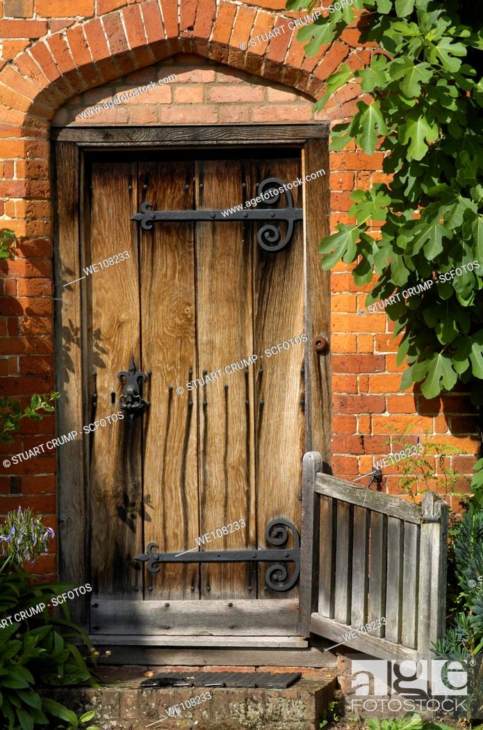 Stock Photo: Traditional Old Wooden Door in an English Cottage Garden, England, United Kingdom.