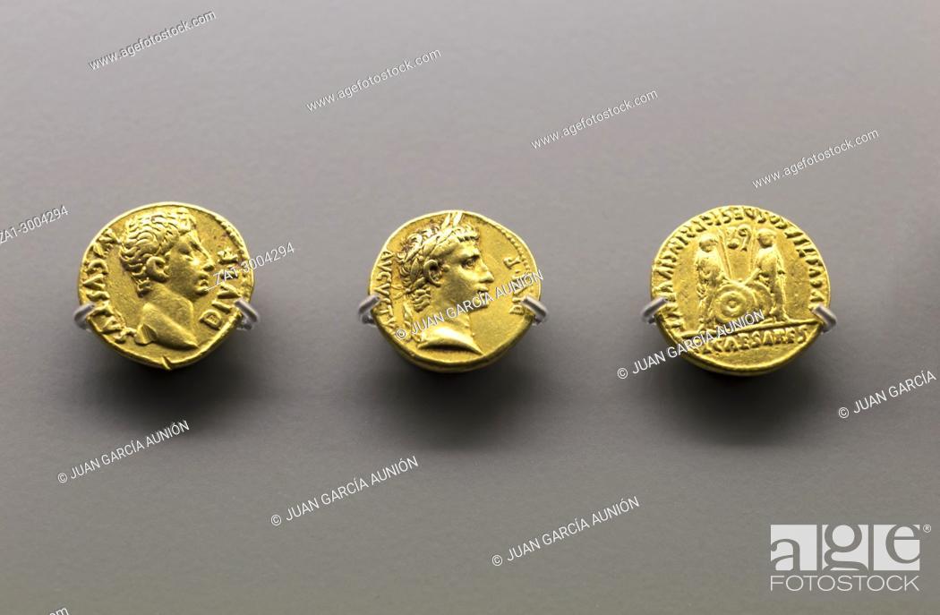 Stock Photo: Three golden coins of Augustus Emperor at National Museum of Roman Art in Merida, Spain.