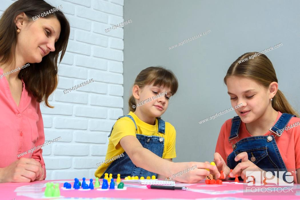 Stock Photo: Family playing card games at the table.