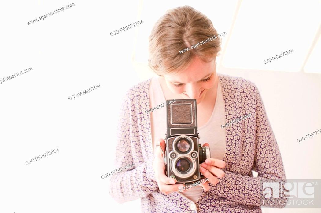 Stock Photo: Woman with retro camera.