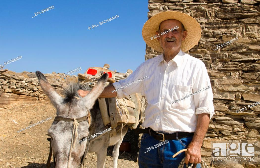 Stock Photo: Greece Paros Cyclades old local man with donkey near Lefkes in mountains at his farm home 8.