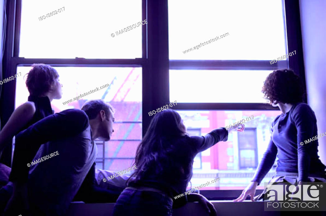 Stock Photo: Silhouetted people at window.