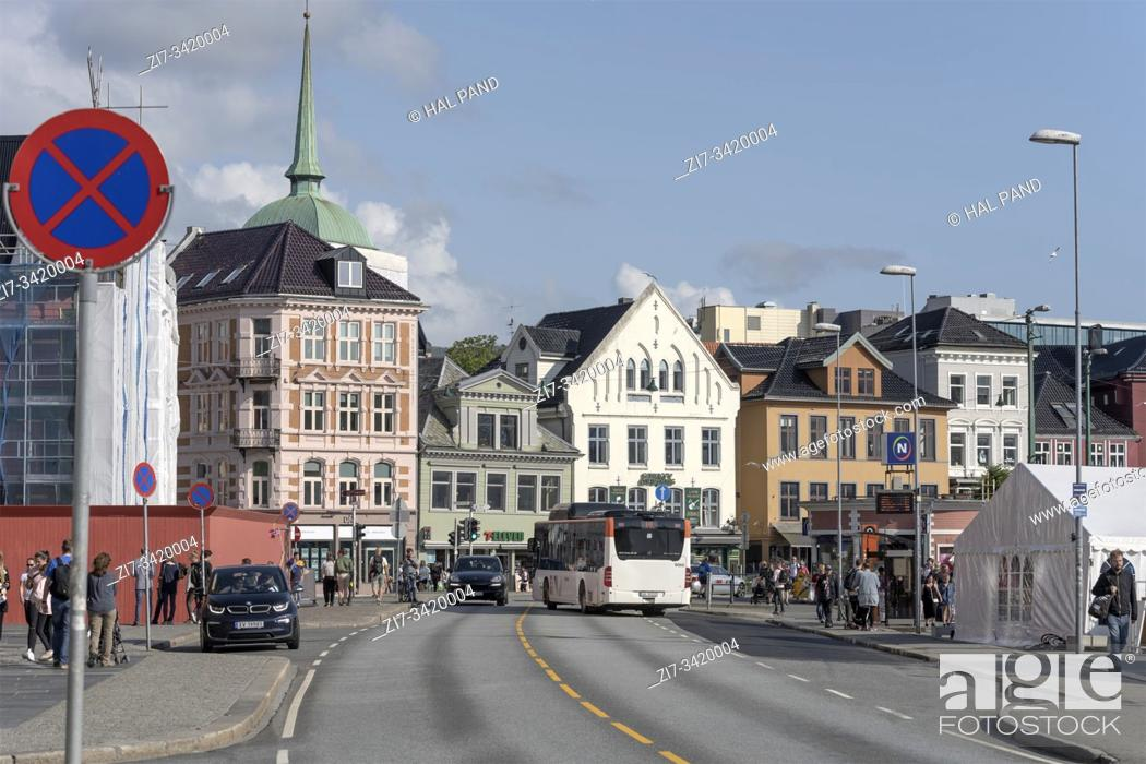 Stock Photo: BERGEN, NORWAY - July 19 2019: touristic town cityscape with bus jammed in traffic at picturesque town center neighborhood.