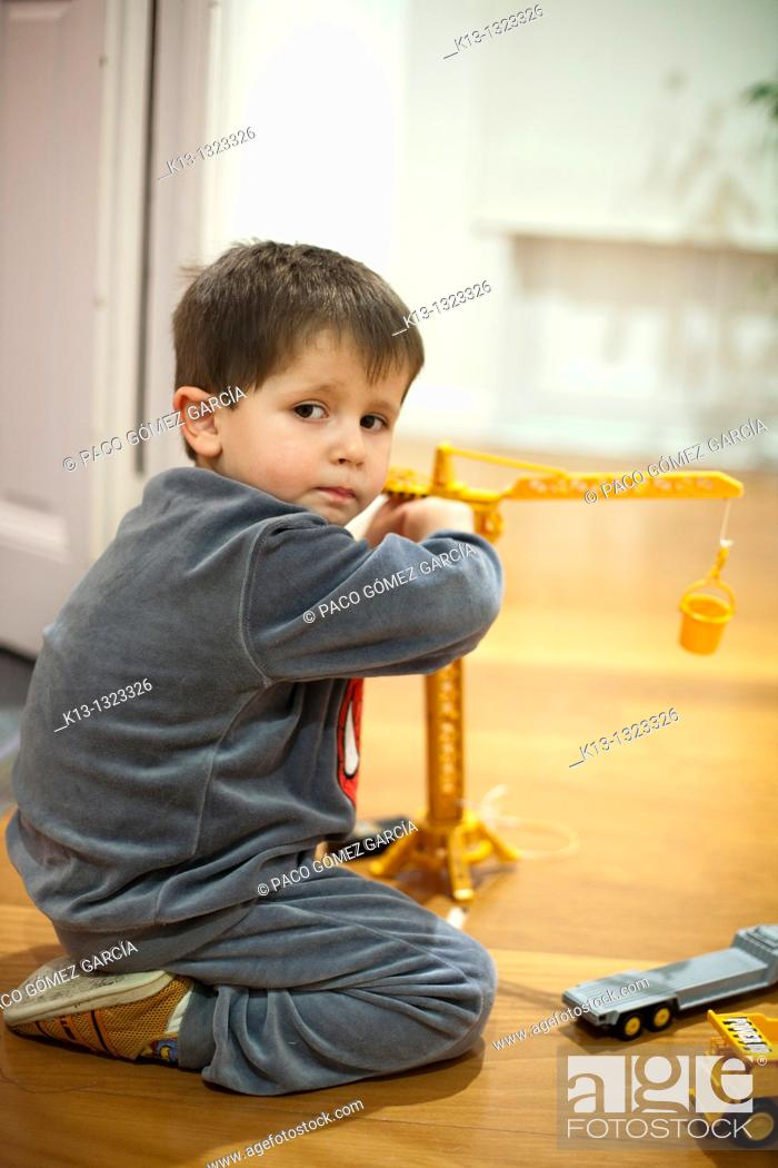 Stock Photo: Children playing with a crane.