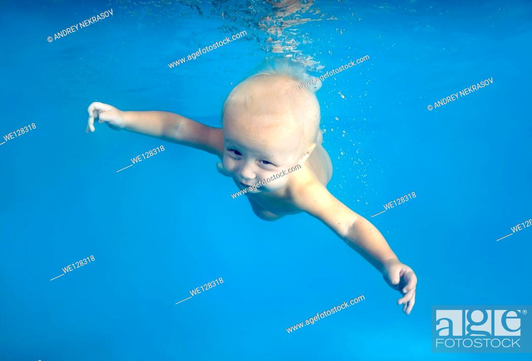 Stock Photo: Baby diving in a pool.