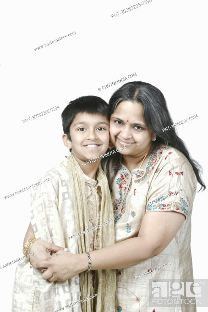 Stock Photo: Portrait of a mature woman hugging her son.