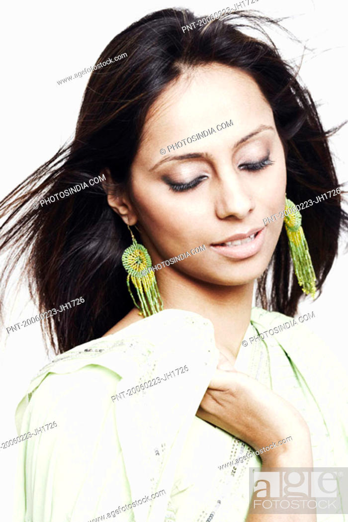 Stock Photo: Close-up of a young woman with her eyes closed.