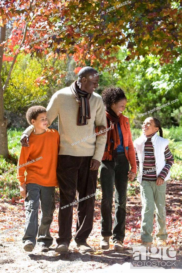 Stock Photo: Family walking outdoors in autumn.