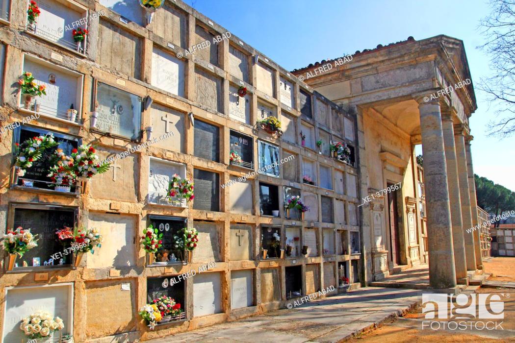 Stock Photo: funerary niches and church columns, Girona municipal cemetery, Catalonia, Spain.