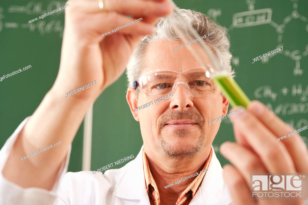 Stock Photo: Germany, Emmering, Senior man doing experiment, close up.