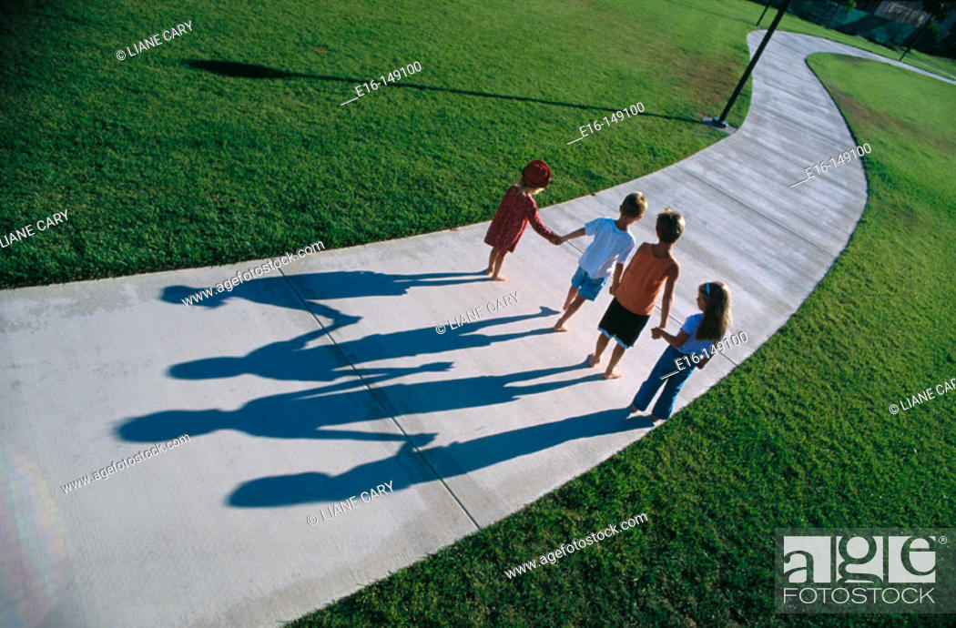 Stock Photo: Children walking down path together.