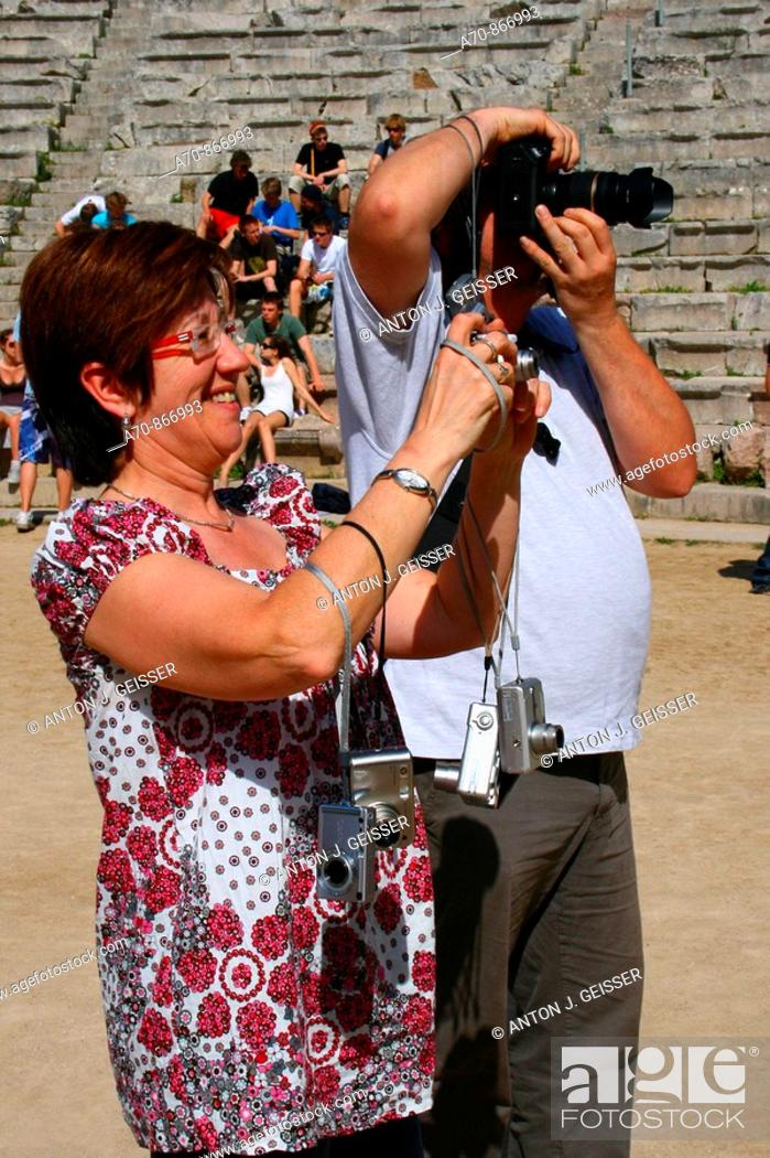 Stock Photo: Tourists taking pictures with their digital cameras. Sanctuary of Asklepios at Epidaurus, Greece.