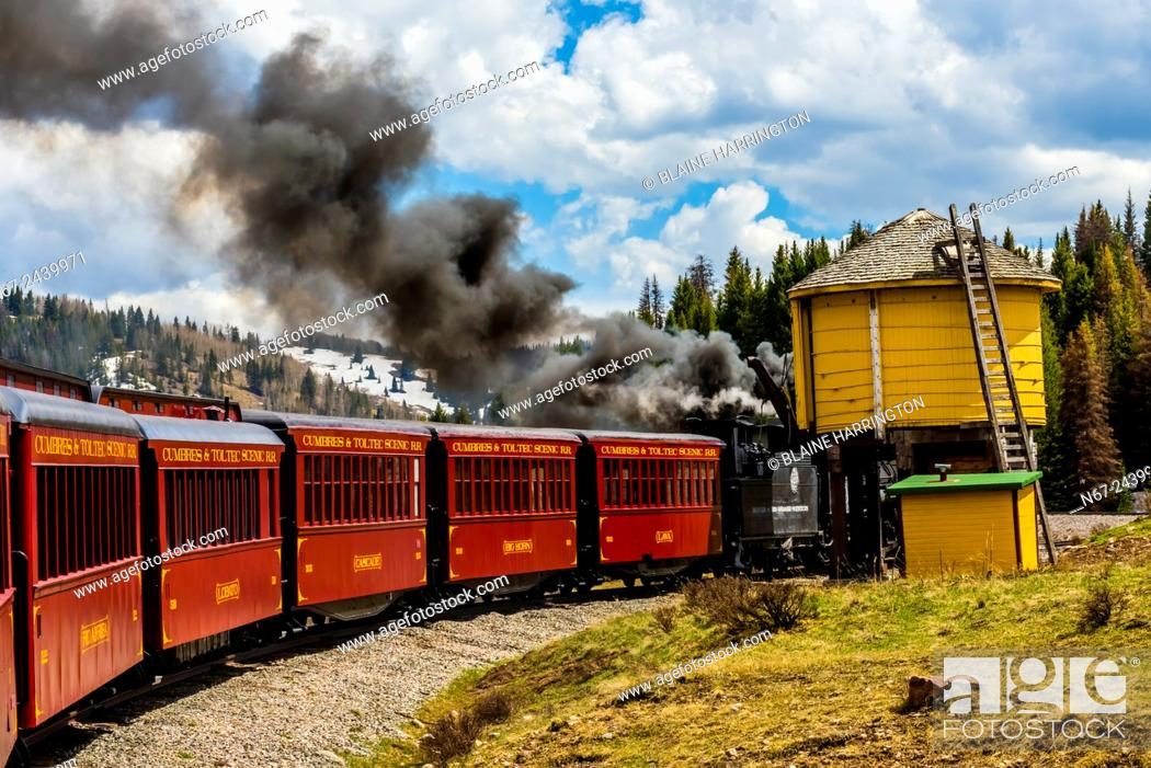 Stock Photo: Cumbres & Toltec Scenic Railroad train takes on water for the boiler of the steam engine on the 64 mile run between Antonito, Colorado and Chama, New Mexico.