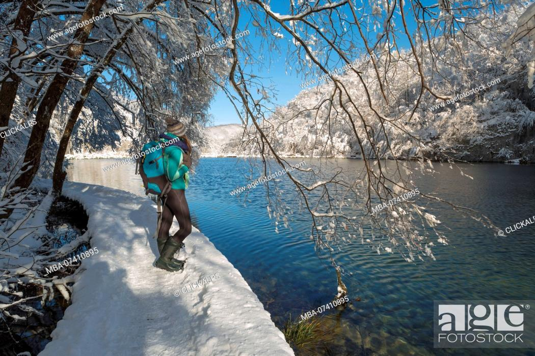 Woman Visiting Plitvice Lakes National Park In Winter