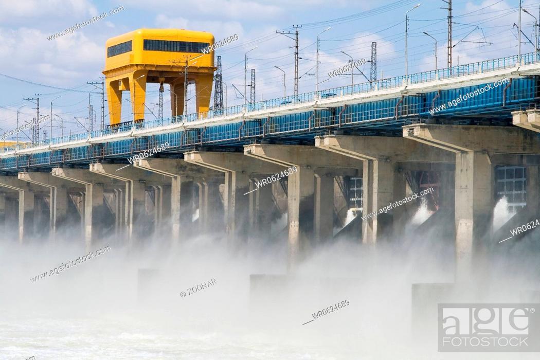 Stock Photo: Reset of water at hydroelectric power station on the river.