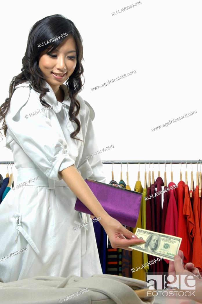 Stock Photo: Woman paying in a clothing store.