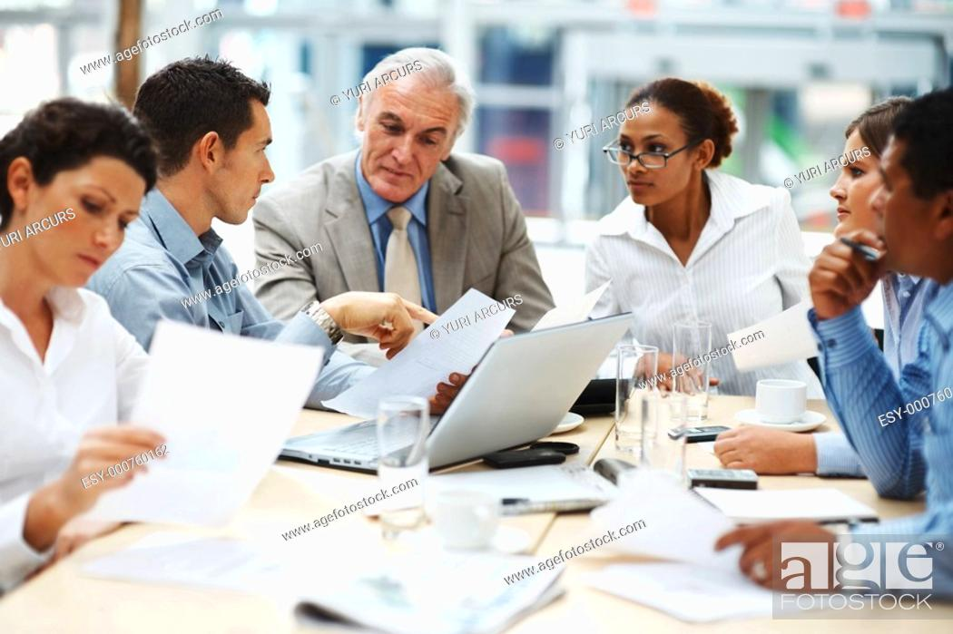 Stock Photo: Multi ethnic business executives at a meeting discussing a work.