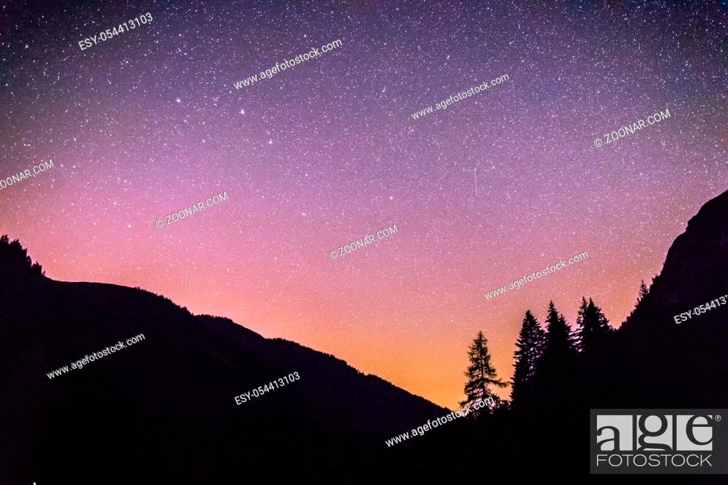 Stock Photo: Milky way clear at night, silhouettes of trees.