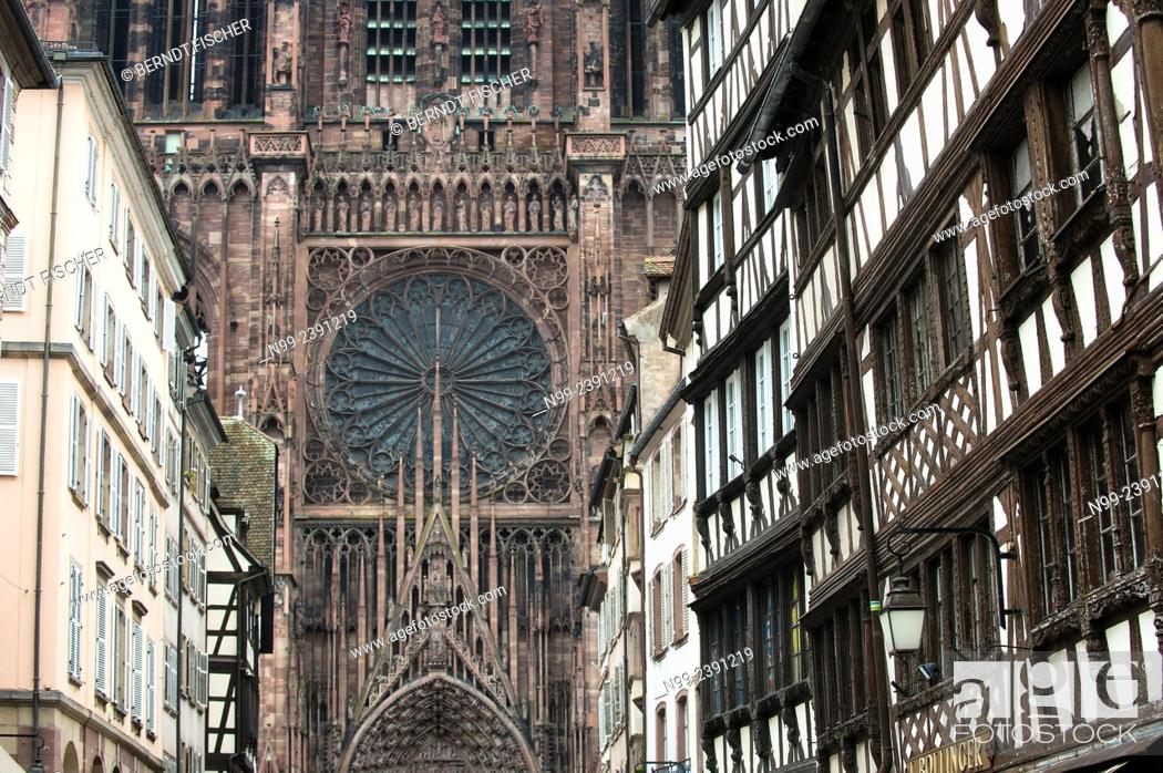 Stock Photo: Strasbourg, frame houses in front of gothic cathedral, Alsace, France.