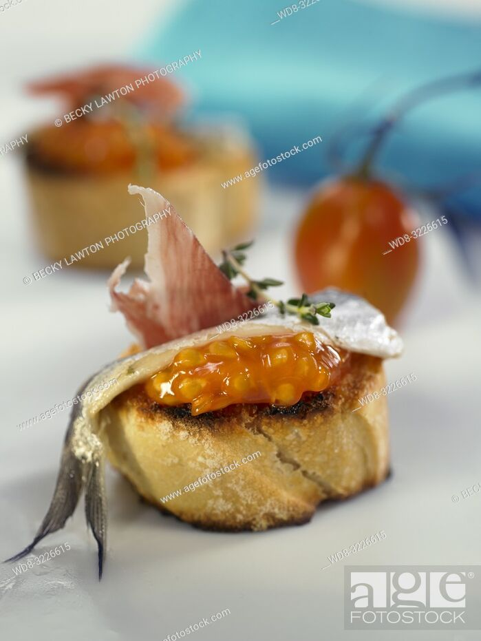 Stock Photo: montadito de boquerones en vinagre con jamon iberico / montadito of anchovies in vinegar with iberian ham.