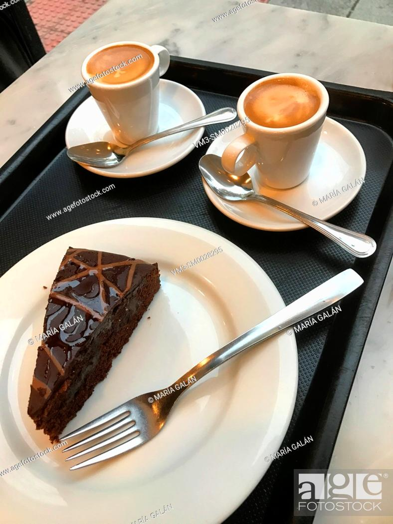 Photo de stock: Chocolate cake and two cups of coffee.