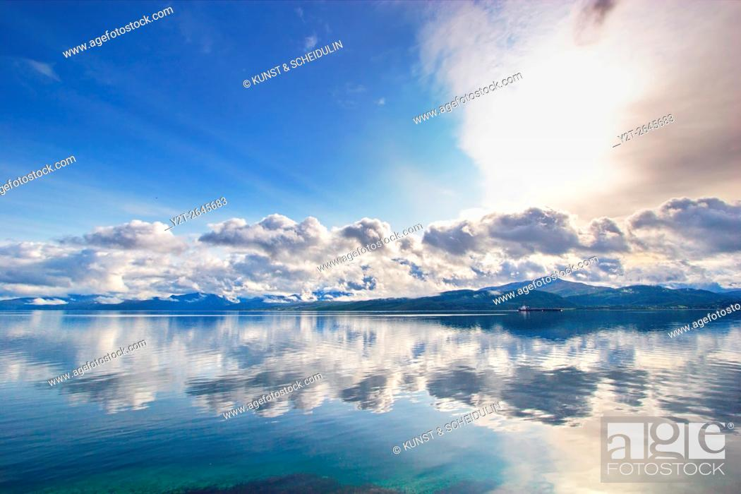 Stock Photo: Mountains are reflected in Ofotfjorden near Evenes in northern Norway.