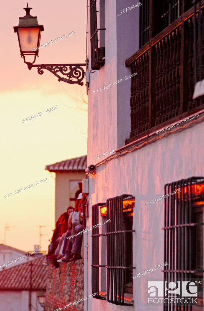 Stock Photo: Façade of house and tourists at sunset in the Albayzin. Grenada. Andalucia. Spain.