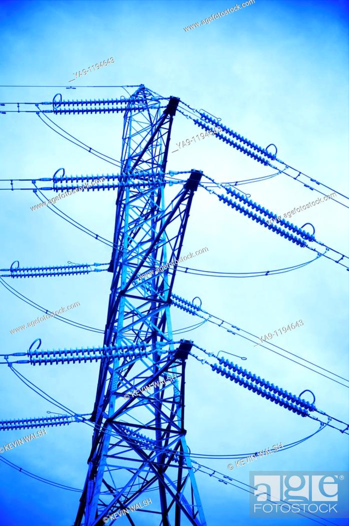 Stock Photo: Electricity tower against the sky toned blue.