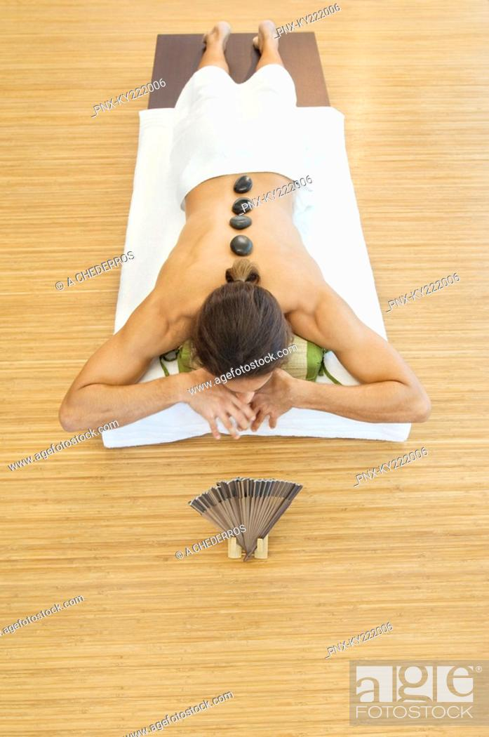 Stock Photo: Man receiving hot stone therapy.