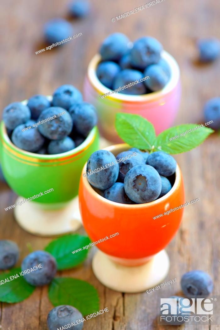 Stock Photo: Fresh blueberries on wooden table.