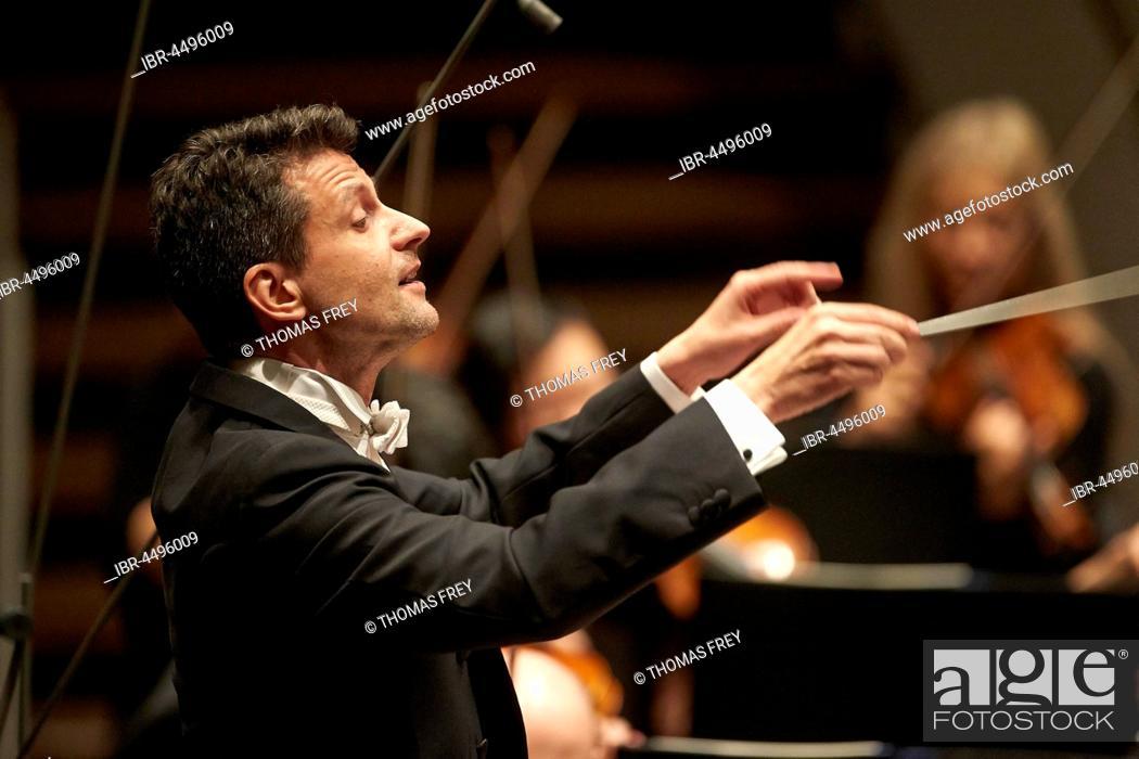 Stock Photo: Conductor Ruben Gimeno conducts Staatsorchester Rheinische Philharmonie, Music Department, Koblenz, Rhineland-Palatinate, Germany.