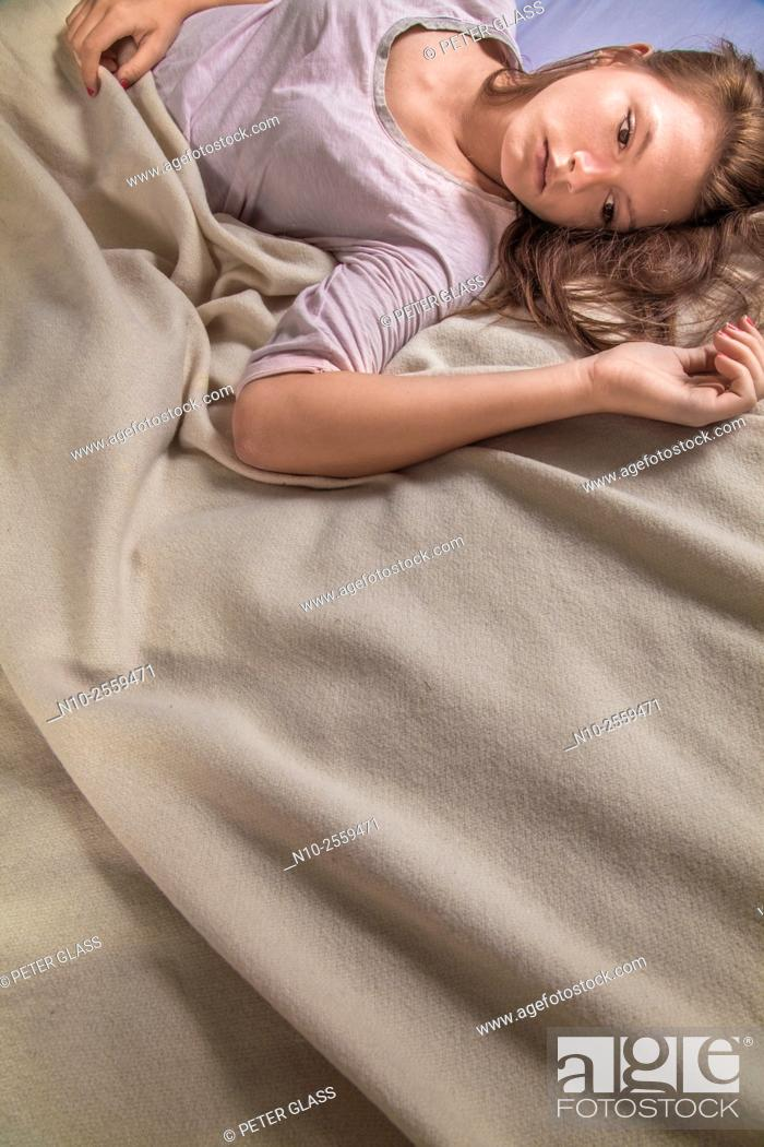Stock Photo: Teenage girl on her bed.